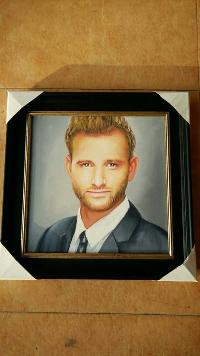 A painting of face, chin, nose, forehead, hairstyle, facial hair, smile, white collar worker, jaw, photo caption
