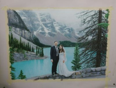 A painting of photograph, wedding, mountain, ceremony, tree, terrain, bride, glacial landform, mountain range, winter