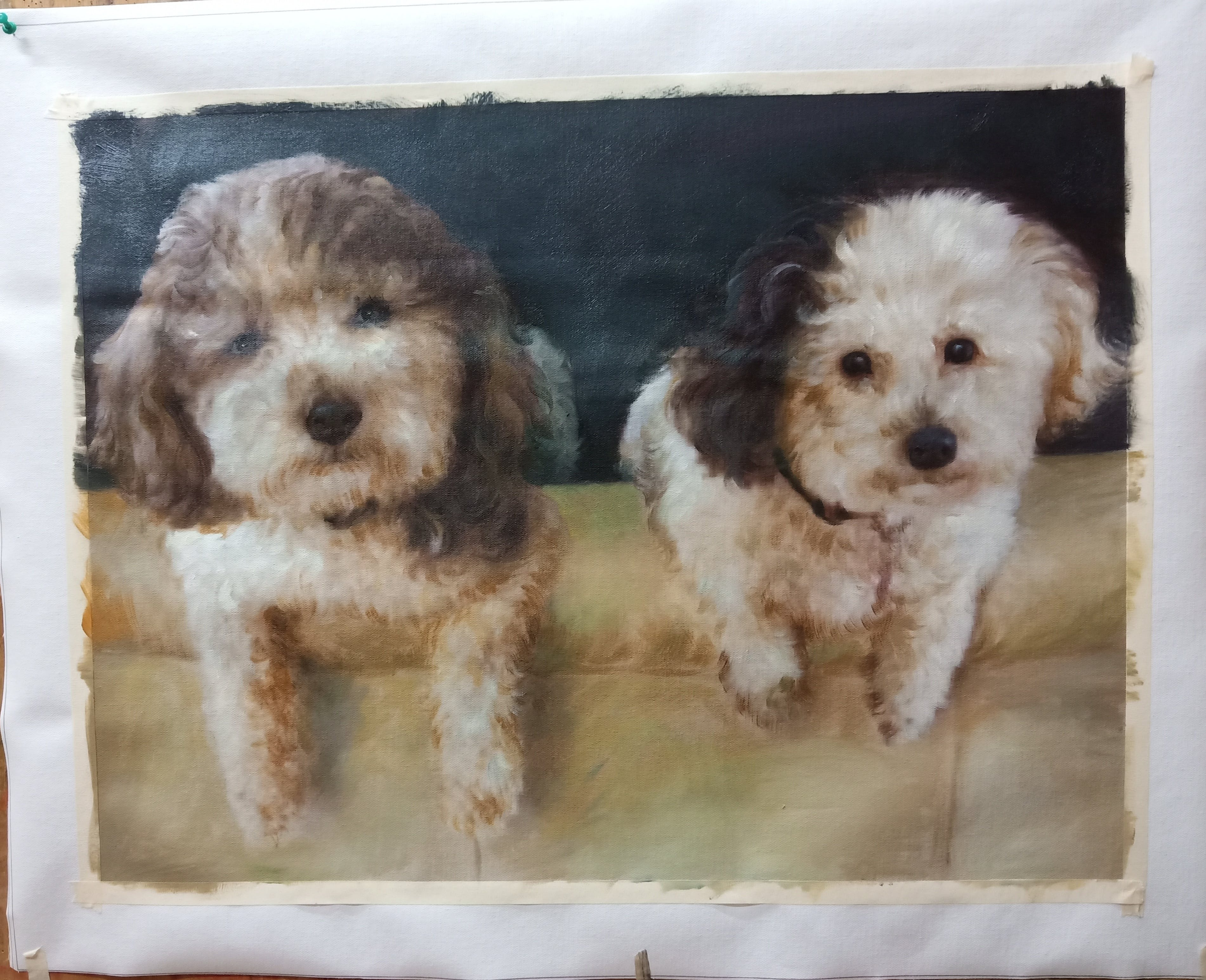 Painting of 2 puppies hanging over the couch with a black background